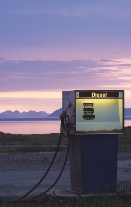 A lone petrol pump in the country side, landscape and sea in background