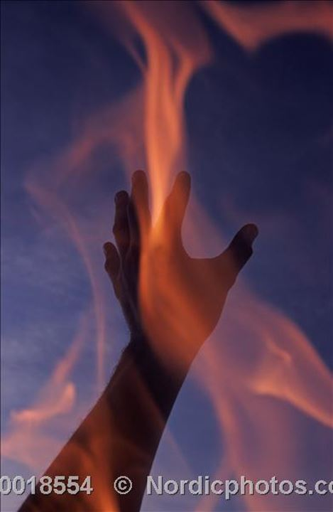 A hand and a flame