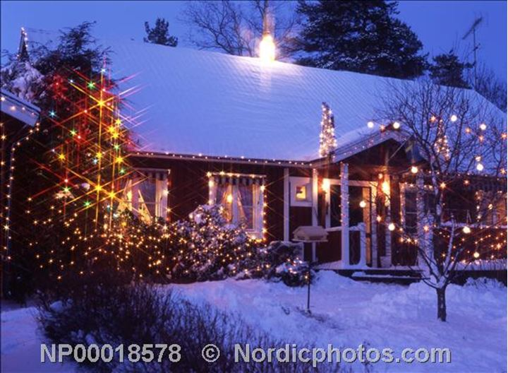 A decorated house with Christmas lights in the trees outside,Kvicksund,Sodermanland.
