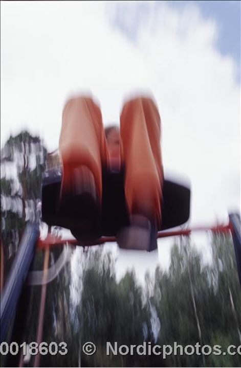 A person on the swings in a playground,Eskilstuna