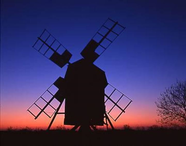 Silhouette of a windmill at dusk, blue and red sky in background,Oland(Öland)