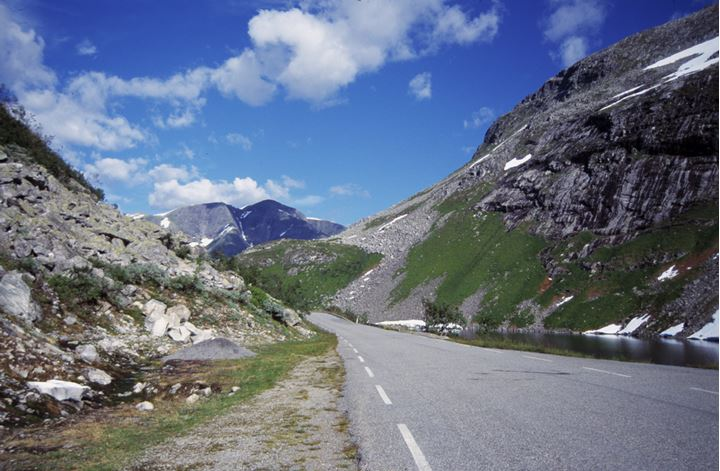 A road leading between two mountains.
