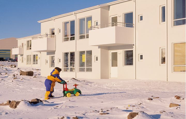 A child playing with a toy car in snow, Reykjavik, Iceland