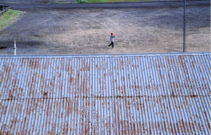 View over a roof and a boy on the ground