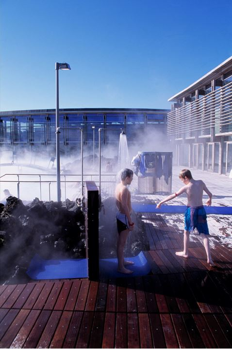 Two boys taking a shower to cool down, the Blue Lagoon.