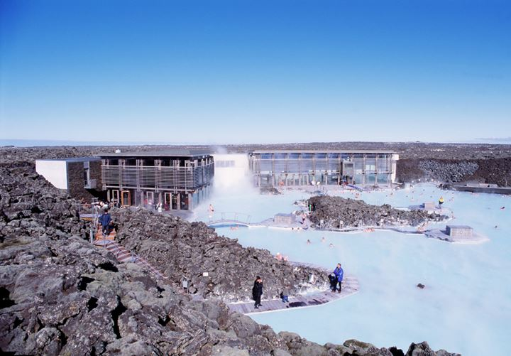 Overlooking the Blue lagoon, the buildings and people relaxing in the lagoon.