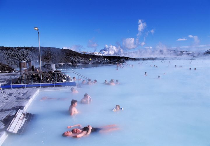 Group of people sunbathing and relaxing at the Blue lagoon.