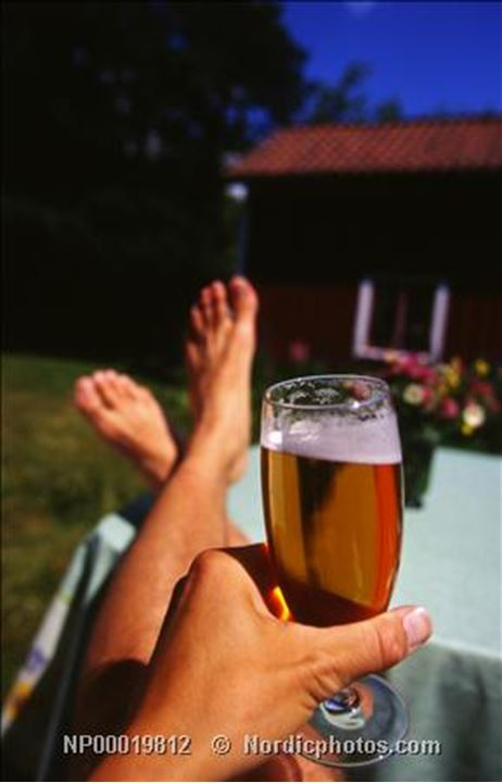 Close-up of a man's hand holding a glass of beer, Sweden