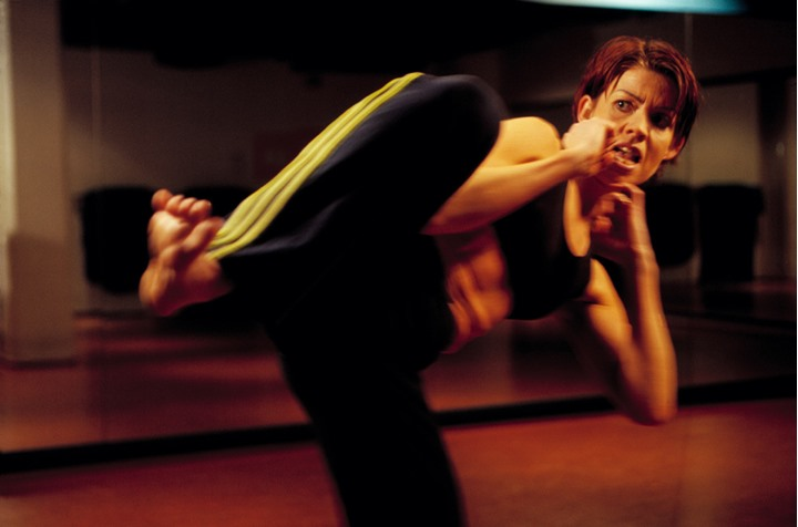 A woman exercising Tae-vo