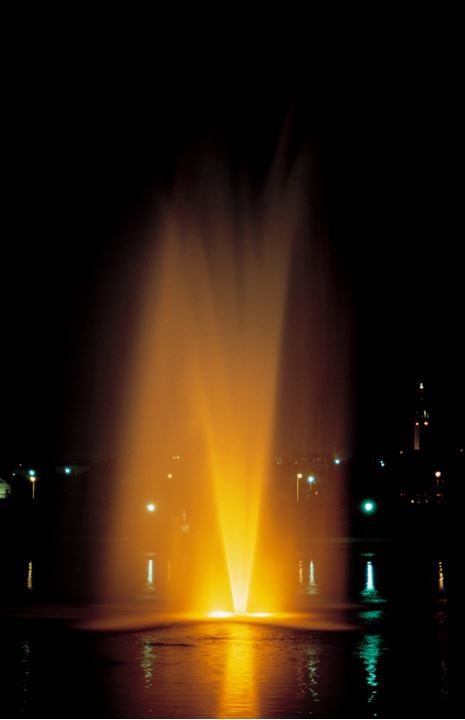 A fountain in the pond in Reykjavik at night