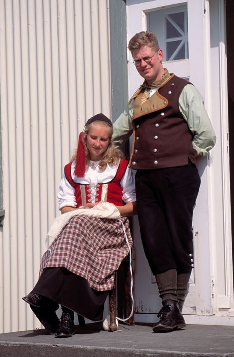 A young man and a young woman wearing traditional Icelandic costumes