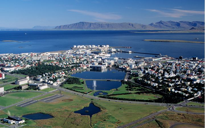 Looking over part of Reykjavik, the pond in the middle and sea and mountains afar
