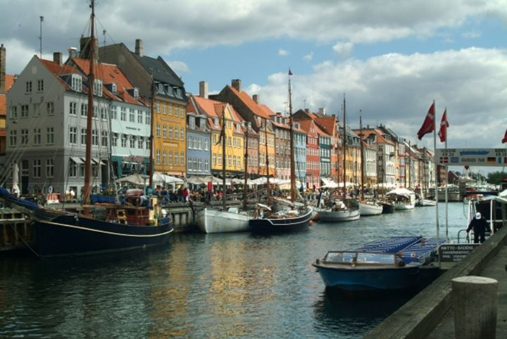 Sailboats docked by a the pier of Nyhavn, Copenhagen