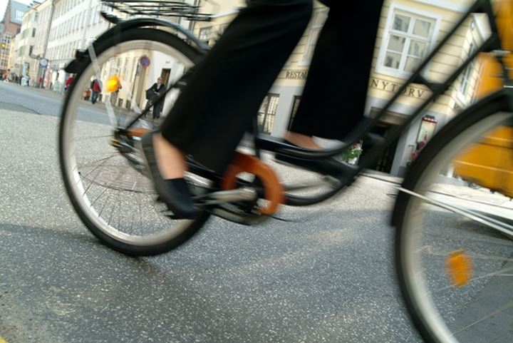 Low section view of a person riding a bicycle on a road