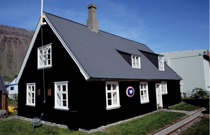 An old, black timber house