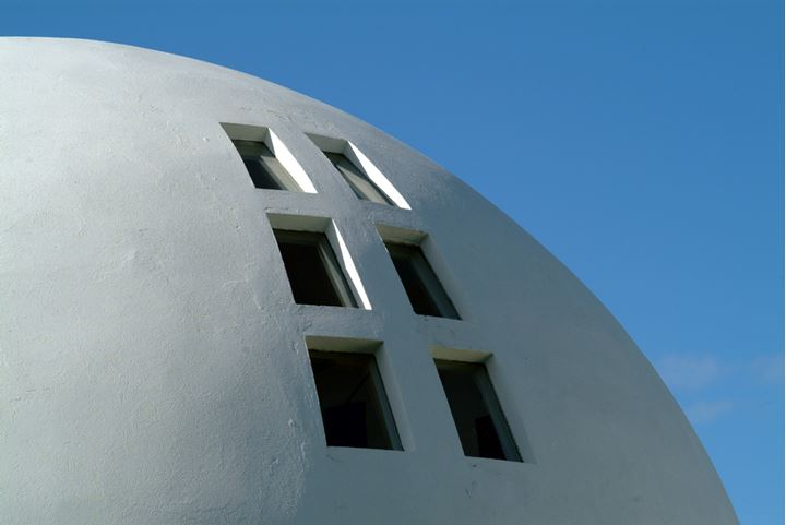 Part of a modern sphere-shaped house and its window