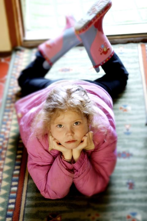 Portrait of a girl lying on a carpet
