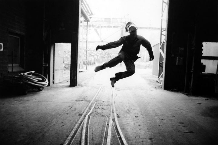 A man jumping in a factory