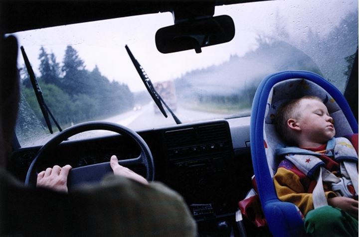 A child sleeping in car seat