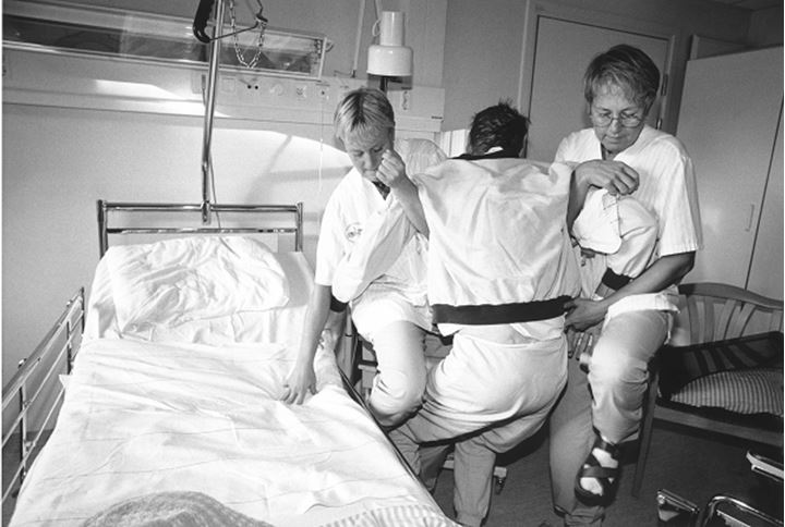 Hospital attendants carrying a patient