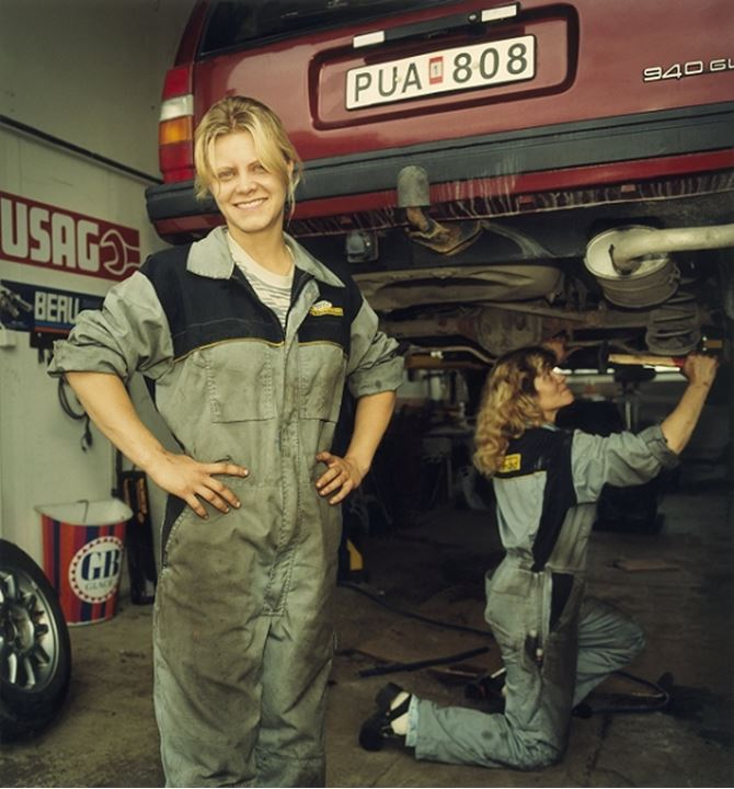 Daughter and mother working in their own car repair shop, Sweden