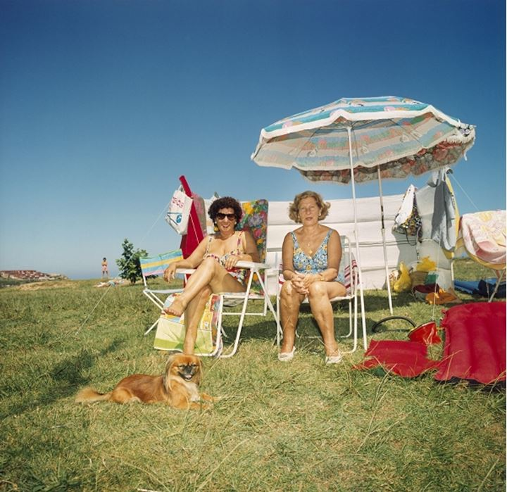 Two women tanning outdoors
