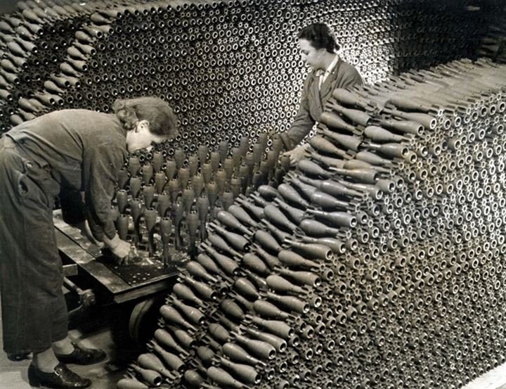 Workers piling shells in a factory