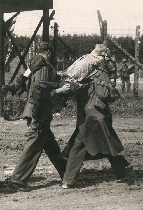 Soldiers carry a skeletal body