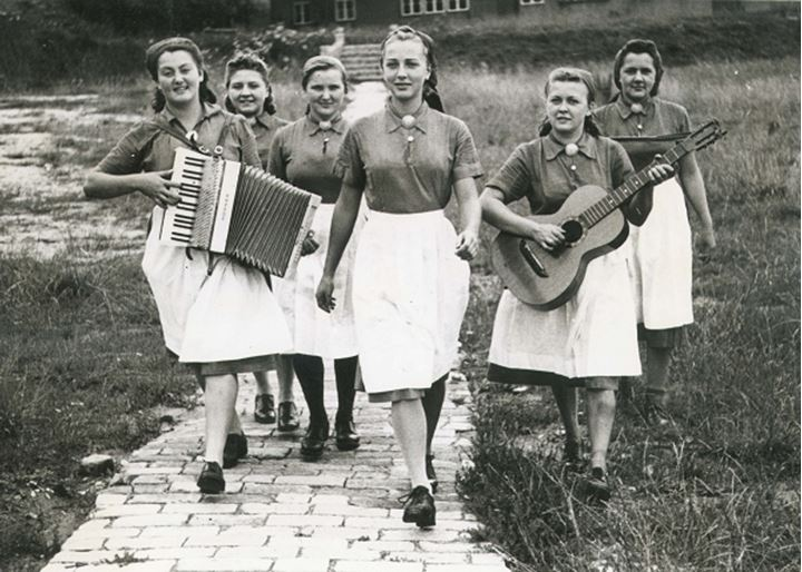 A group of women outside with musical instruments