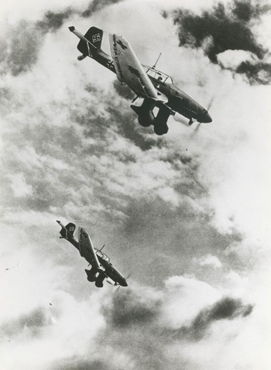 Two planes flying in the clouds