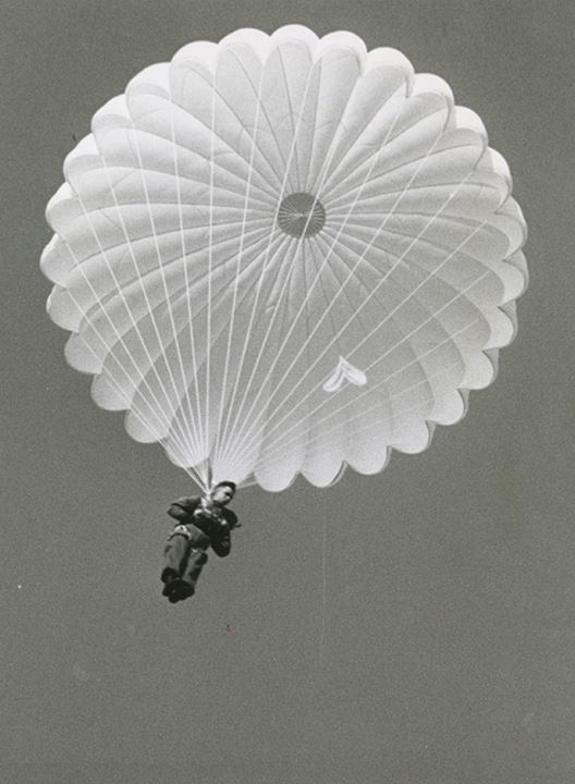 A soldier parachutes from the sky