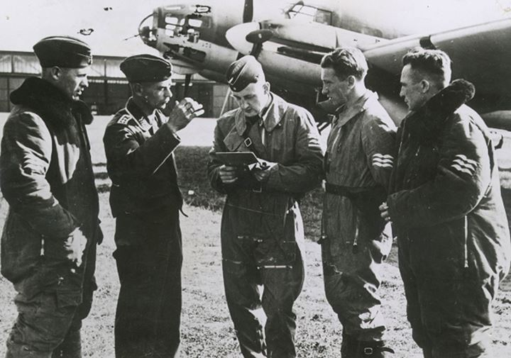 A group of pilots looking at a clipboard
