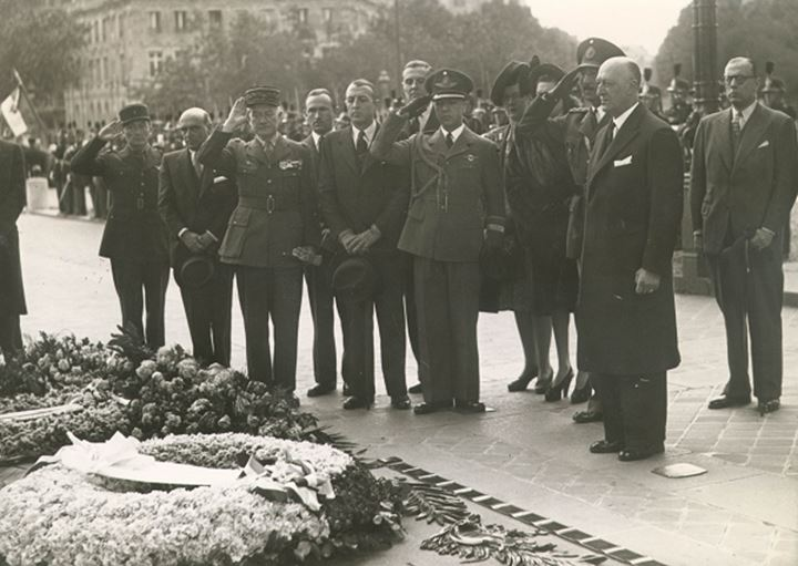A group of soldiers salute at a military funeral