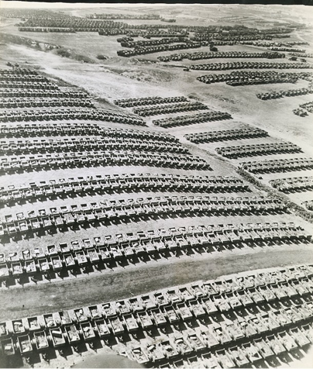 Rows of military equiptment arranged on a hill