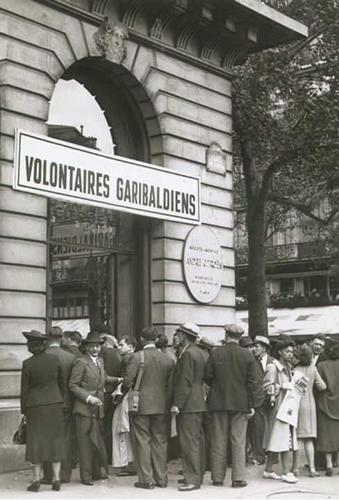 People gathered outside a volunteer station