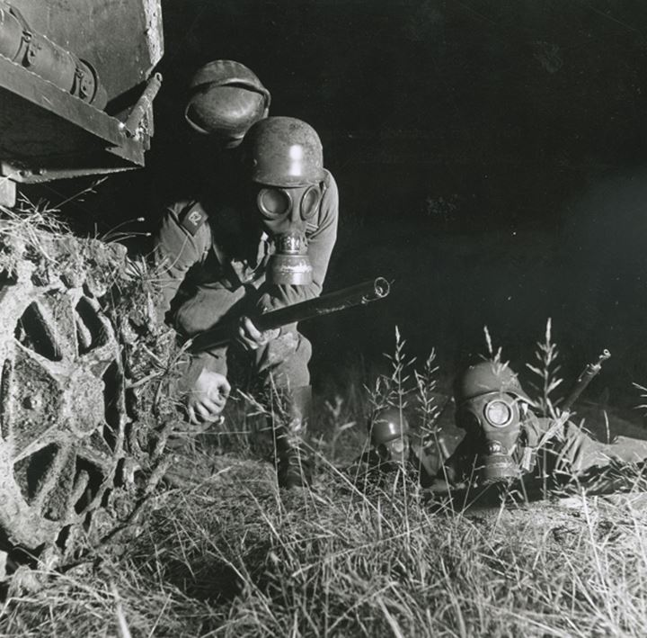 Soldiers in gas masks weilding flamethrowers