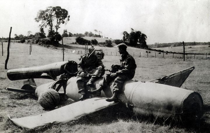Soldiers sintting on a flying bomb