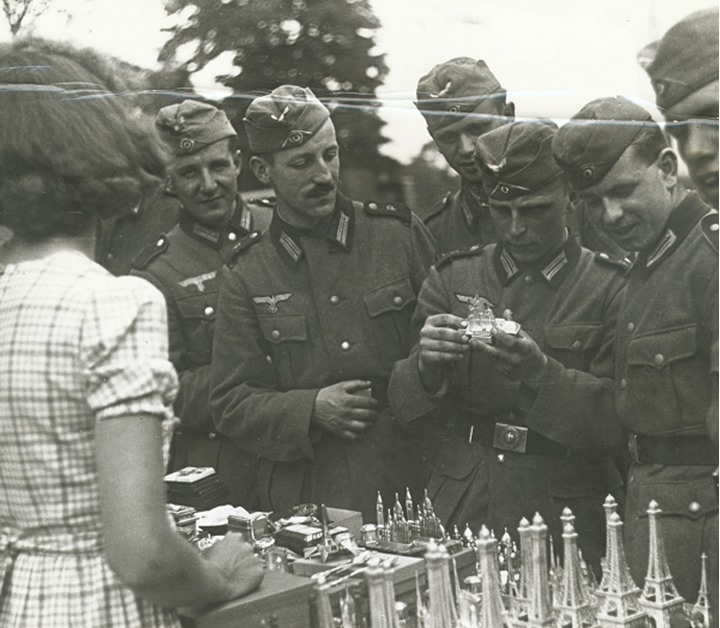 A group of soldiers buying souvenirs