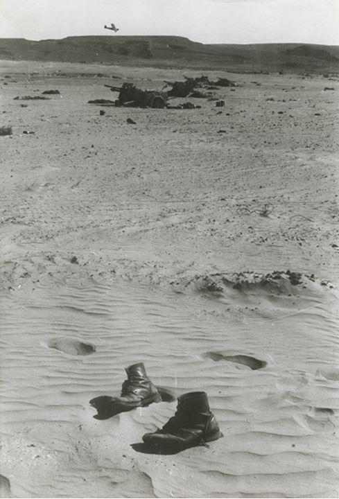 A pair of boots stuck in the sand