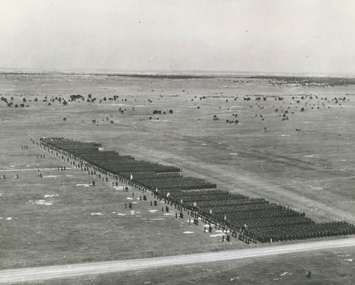 Soldiers line up in formation seen from a distance