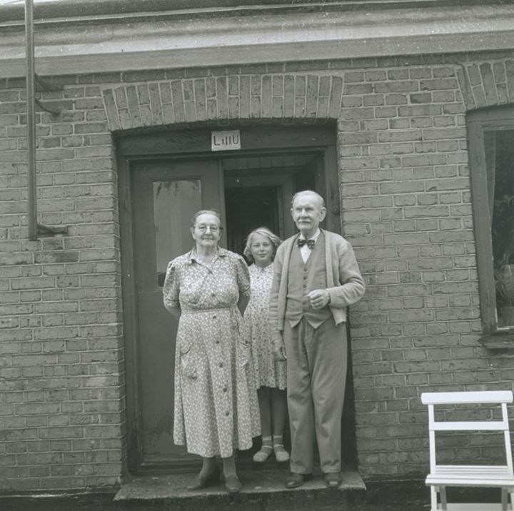 A family posing in a doorway