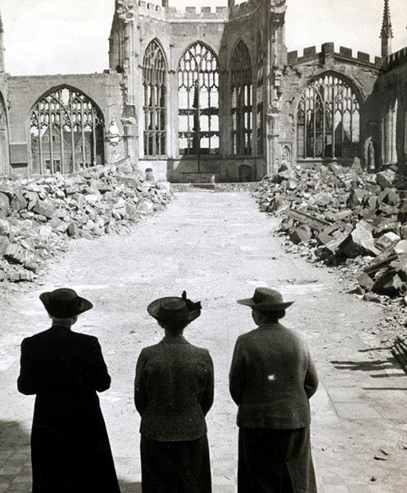 People looking at a destroyed church