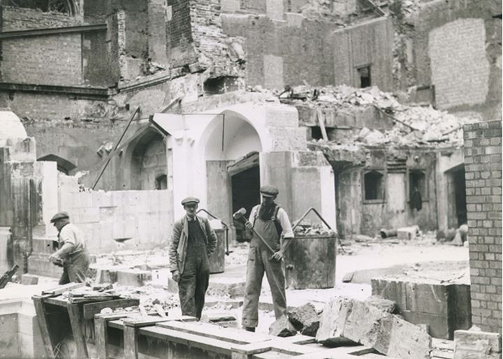 Men working on destroyed building site
