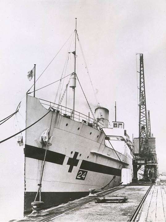 A red cross ship at dock