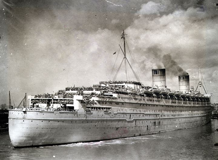 An ocean liner filled with troops