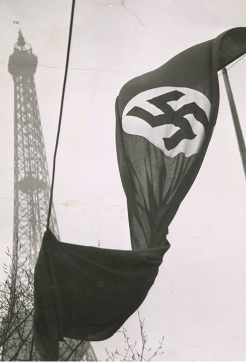 Close up of nazi flag with Eiffel Tower in background