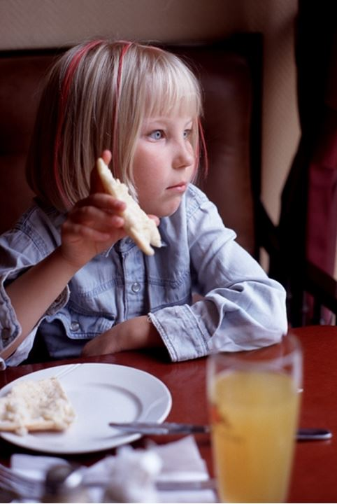 A girl holding bread