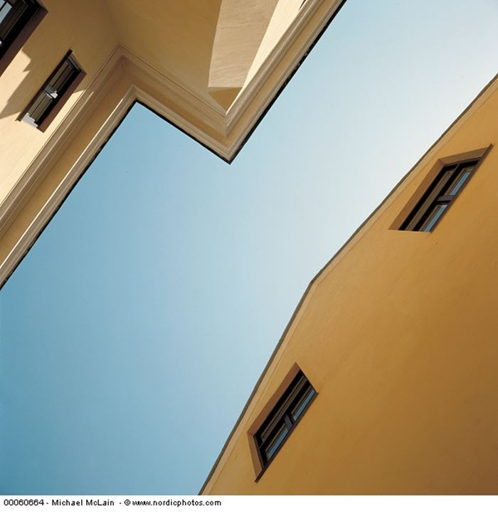 Looking up on two houses