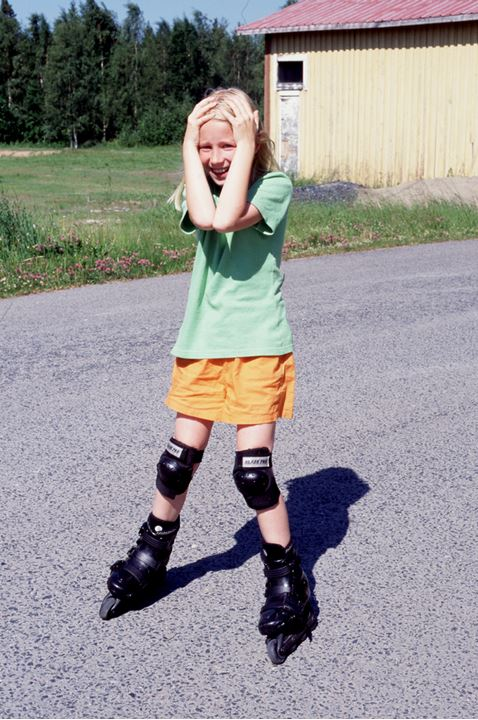 A frighting girl on roller skates