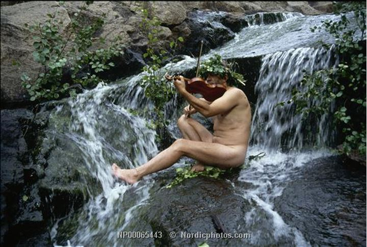 Nude in front of a waterfall
